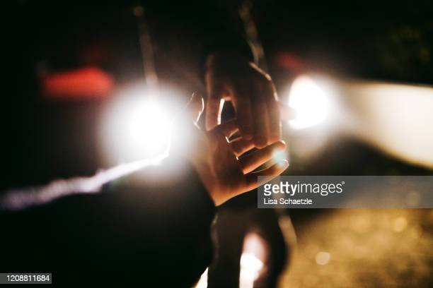 hands of a couple touching - lisa strain stock pictures, royalty-free photos & images