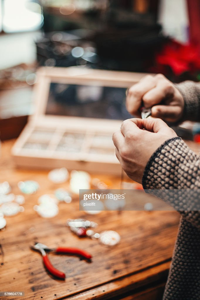 Hands of a craftpeson : Stock Photo