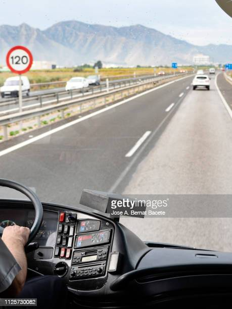 hands of a driver of bus to the steering wheel driving for a road of several rails, highway  a 7 - e 15, spain, europe. - dashboard camera point of view stock photos and pictures