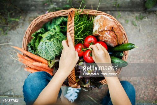 Hands Of A Girl With Harvested Vegetable