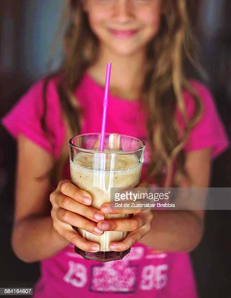 hands of a happy girl holding a fruit smoothie - sorbet stock pictures, royalty-free photos & images