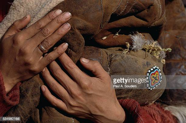 hands of a koryak woman - woman breastfeeding animals stock photos and pictures