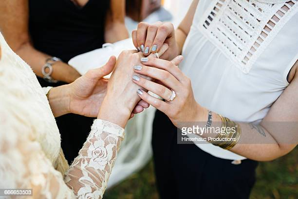 Hands of a lesbian couple during their wedding
