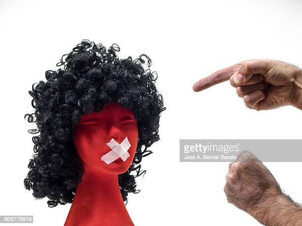 Hands of a man doing gestures of harassment and ill-treatment to a woman