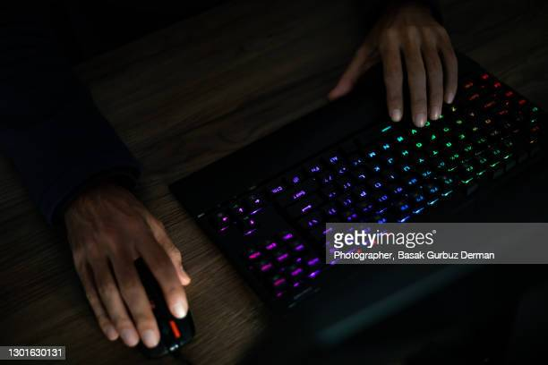 hands of a man typing on computer keyboard and computer mouse - microsoft stock pictures, royalty-free photos & images