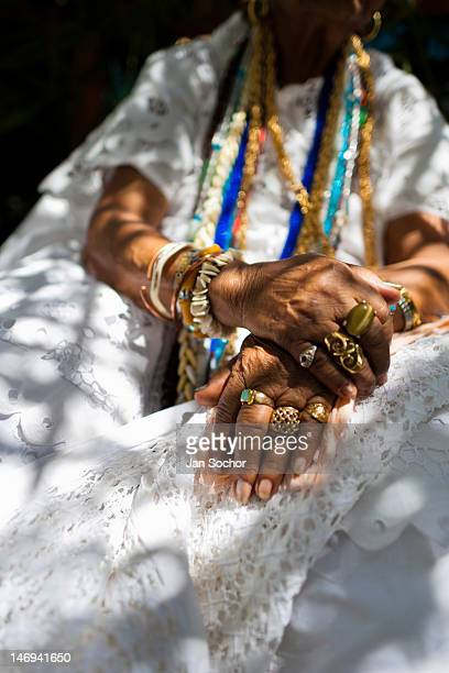 Hands of a priestess of Candomblé seen during the ritual ceremony in honor to Yemanjá the goddess of the sea on 5 February 2012 in Cachoeira Bahia...
