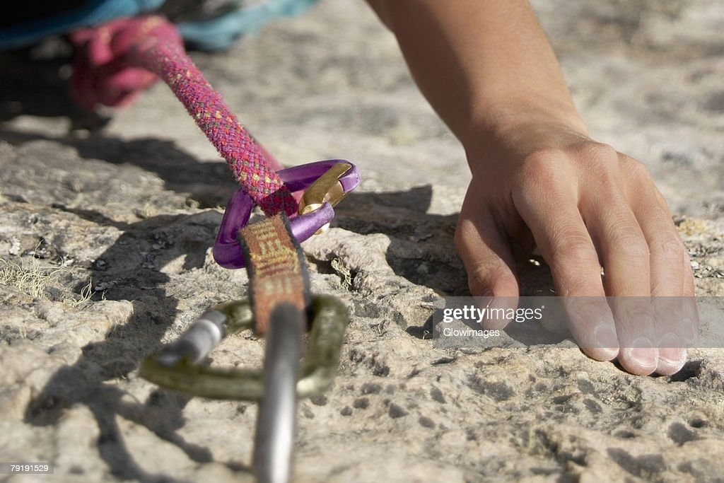 Hands of a rock climber gripping a rock : Stock Photo