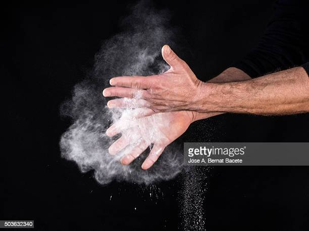 Hands of a sports man rubbing them with powders of talc