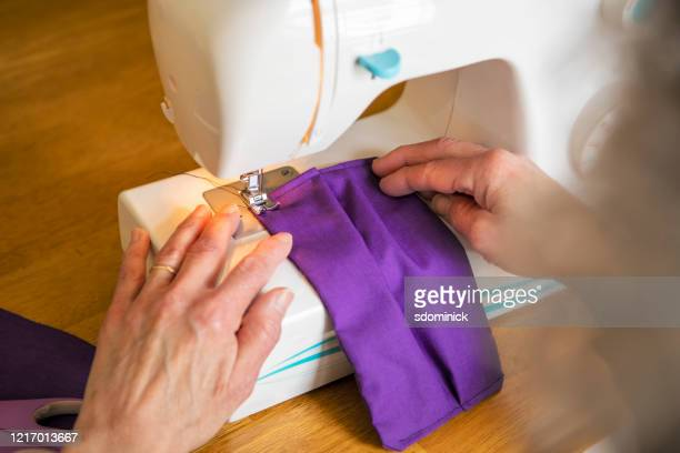 hands of a woman sewing face mask - cloth mask stock pictures, royalty-free photos & images