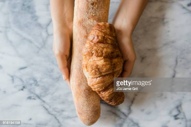 Hands of African American woman holding bread