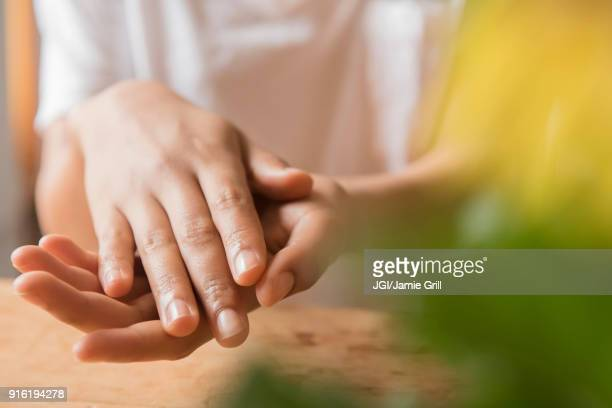 hands of african american woman - mani incrociate foto e immagini stock
