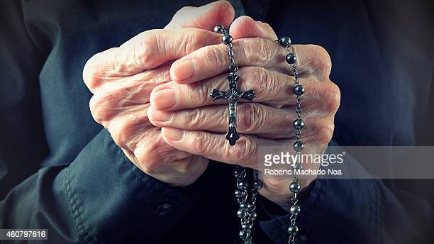 Hands of an elder woman holding a rosary while prayingChristian daily devotional of a worshiper relationship with God the Creator and Savior