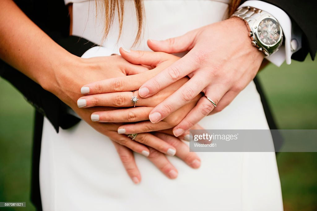 hands of bridal couple with the wedding rings stock photo - Wedding Rings On Hands