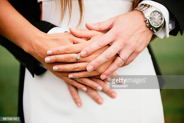 Hands of bridal couple with the wedding rings