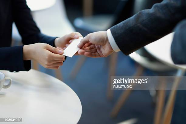 hands of business people giving business card - 名刺 ストックフォトと画像