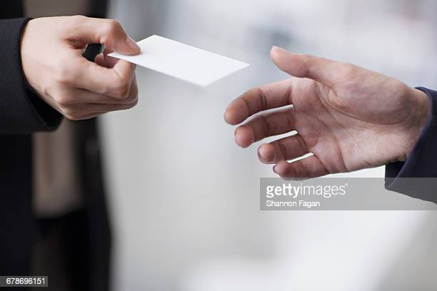 Hands of business people giving business card