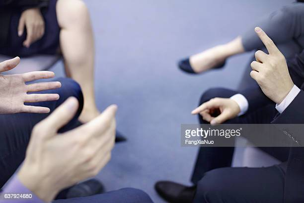 hands of business people interacting in office meeting - teilnehmen stock-fotos und bilder