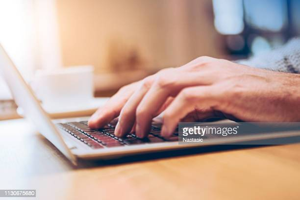 Hands of business person working on computer