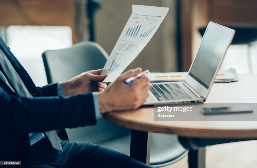 Hands of Businessman Notebook and documents working : Stock Photo