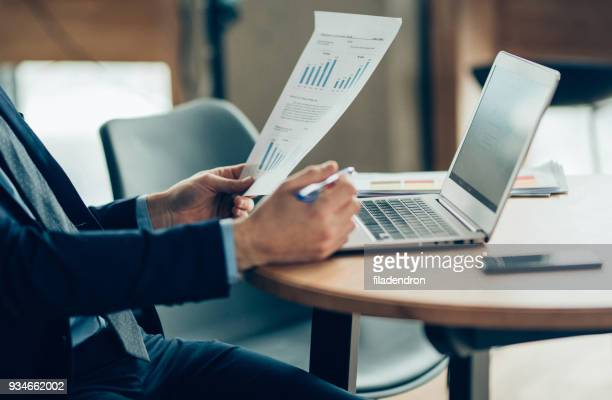 hands of businessman notebook and documents working - analysing stock pictures, royalty-free photos & images