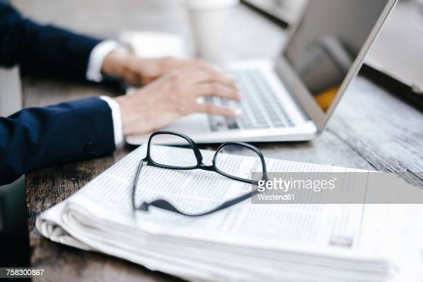 Hands of businesswoman using laptop in a cafe
