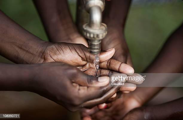 hands of children with water - hygiëne stockfoto's en -beelden