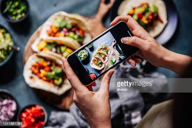 hands of cook photographing mexican tacos - photographing stock pictures, royalty-free photos & images