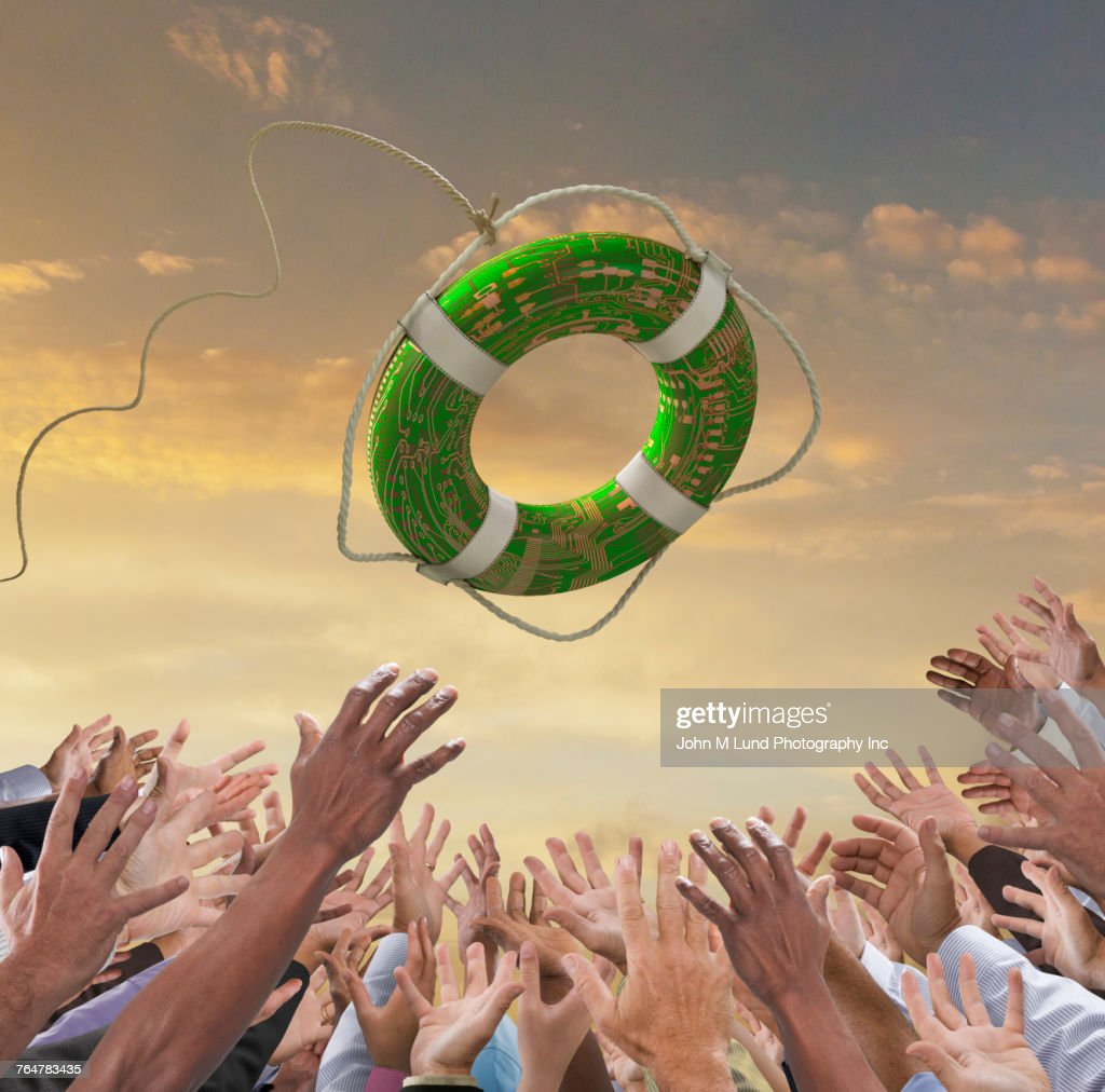 Hands of crowd reaching for green life ring : Stock Photo