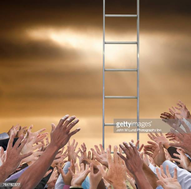 Hands of crowd reaching to ladder in sky