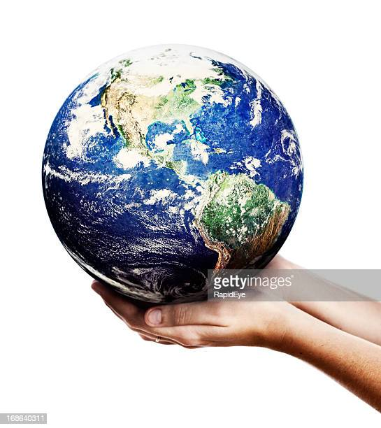 Hands of eco warrior cradle Planet Earth gently: someone cares!