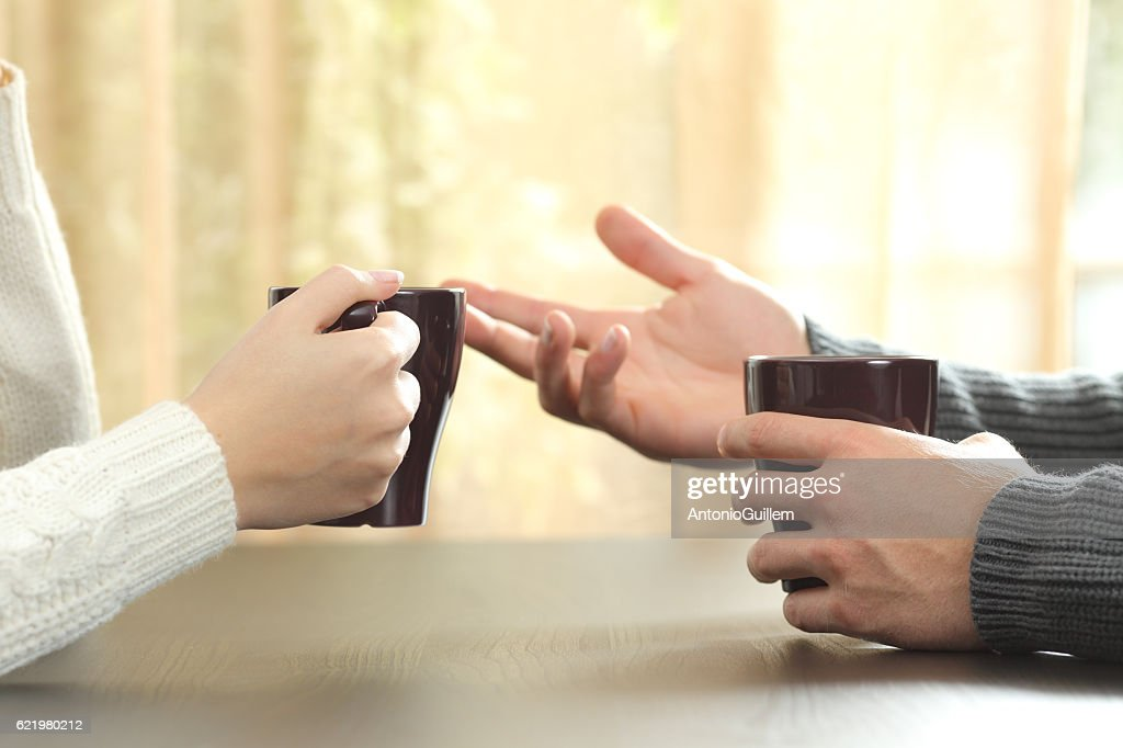 Hands of friends with coffee cups : Stock Photo
