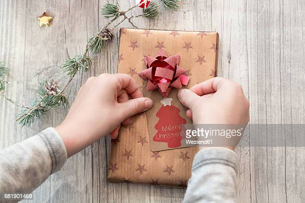Hands of girl wrapping Christmas present