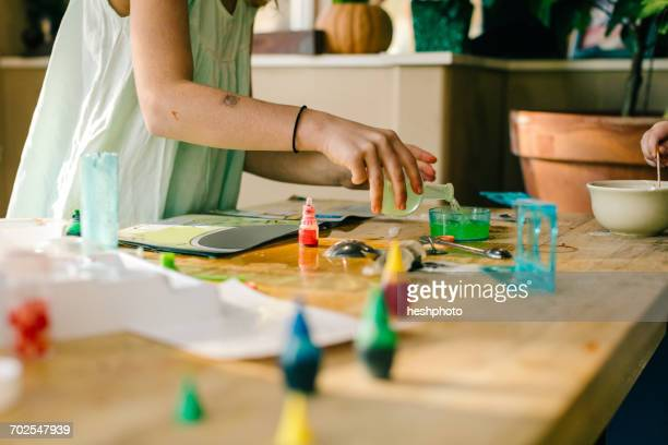 hands of girls doing science experiment, with chemistry set at table - heshphoto ストックフォトと画像