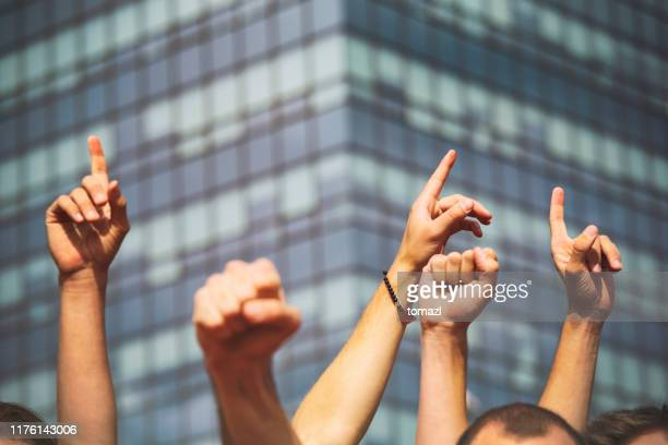 hands of joy or protest - striker stock pictures, royalty-free photos & images