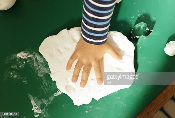 Hands of little boy touching clay,close up