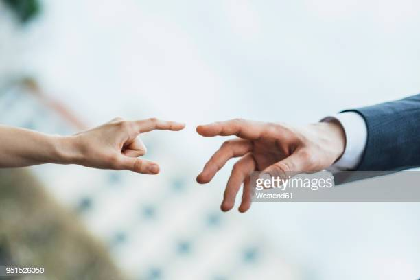 hands of man and woman about to touch - reaching stock pictures, royalty-free photos & images