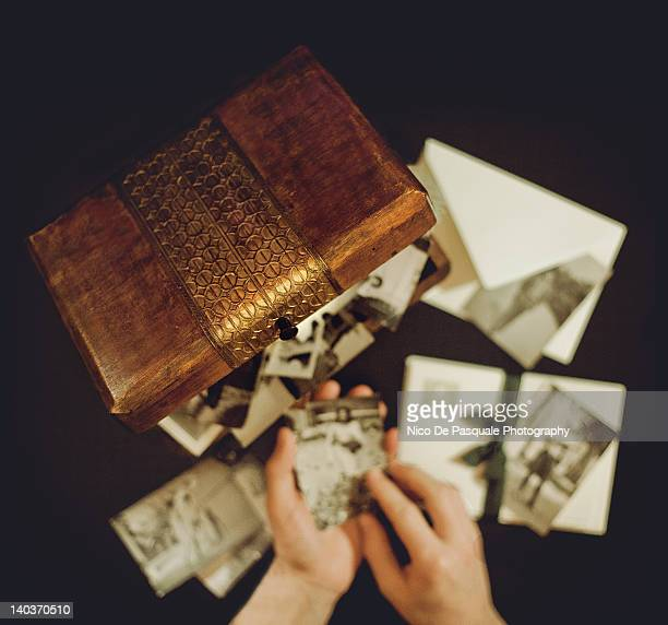 hands of man holding old photographs - nico de pasquale photography stock pictures, royalty-free photos & images