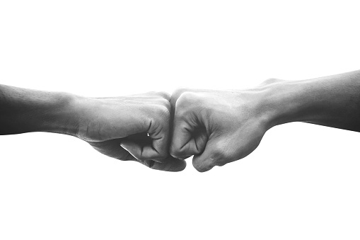 Hands of man people fist bump team teamwork and partnership business success, Black and white image 1133580260