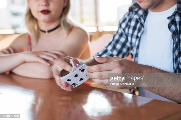 hands of man shuffling cards - shuffling stock photos and pictures