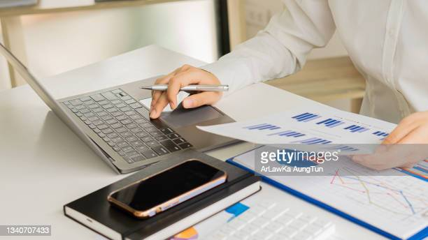 hands money making calculating desk about