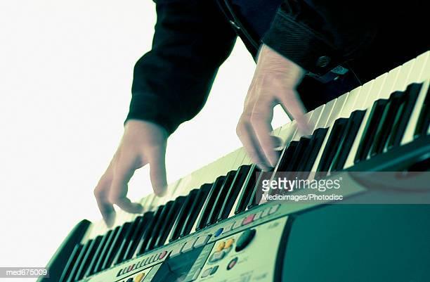 hands of  musician on keyboard - キーボード奏者 ストックフォトと画像