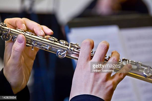 Hands of musician playing flute