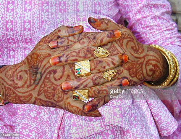 Hands of Neelam, leader of a community of eunuchs in Old Delhi. Neelam did not want her face photographed but agreed to an image of her hennaed...