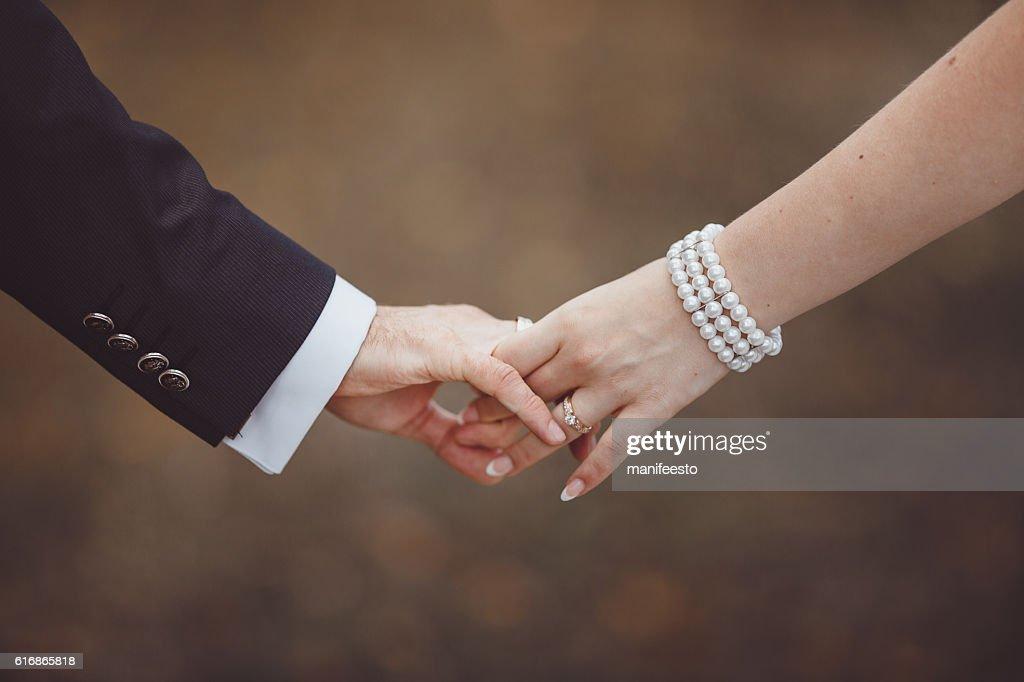 Hands of newlyweds. : Stock Photo
