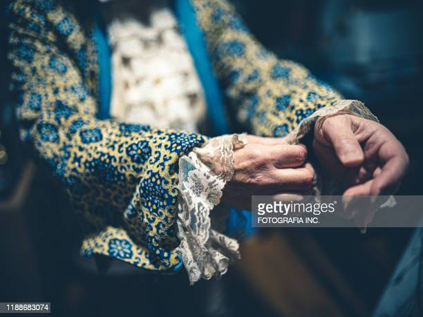 hands of opera singer getting ready in dressing room - period costume stock pictures, royalty-free photos & images