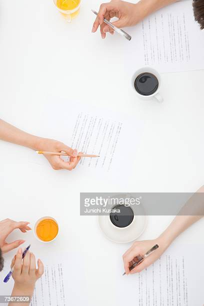 Hands of people meeting at desk