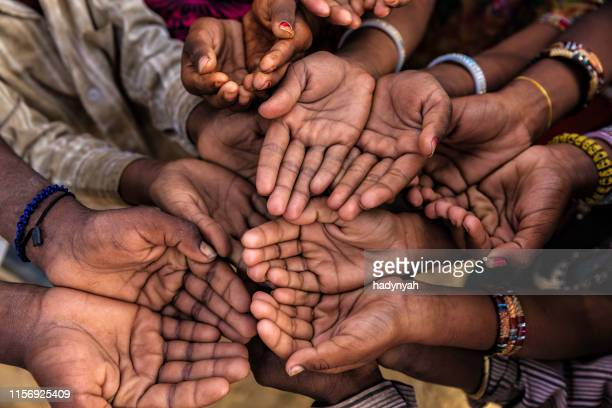 hands of poor - asking for help, africa - sudan famine boy stock photos and pictures