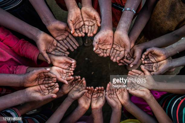 hands of poor - asking for help, africa - giving tuesday stock pictures, royalty-free photos & images