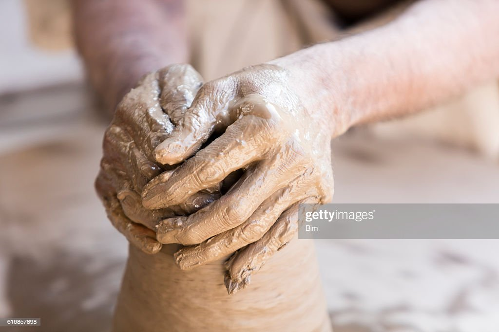 Hands of potter making clay pot, Rajasthan, India : Stock Photo