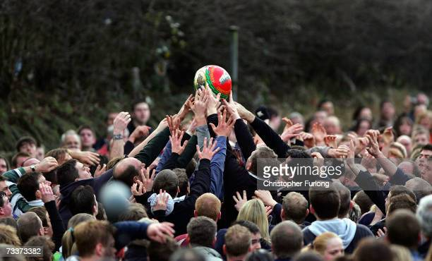 """Hands of rival teams 'Up'ards' and 'Down'ards' battle for the ball in the annual Shrove Tuesday """"no rules"""" football match on February 20, 2007 in..."""